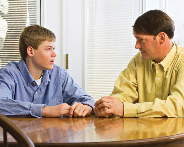 Mormon father talking to son