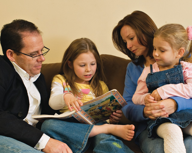 Mormon family shares a story time.